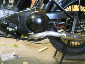 Under wrapping exhaust, left side